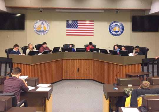 Fond du Lac Youth in Government members learn about local government at the City/County Government Day. Delegates held mock city council and county board meetings at the City/County building.