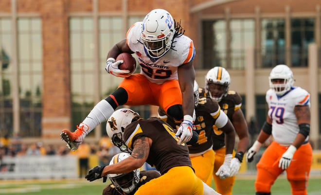 Sep 29, 2018; Laramie, WY, USA; Boise State Broncos running back Alexander Mattison (22) scores a touchdown against Wyoming Cowboys safety Marcus Epps (6) during the first quarter at Jonah Field War Memorial Stadium. Mandatory Credit: Troy Babbitt-USA TODAY Sports