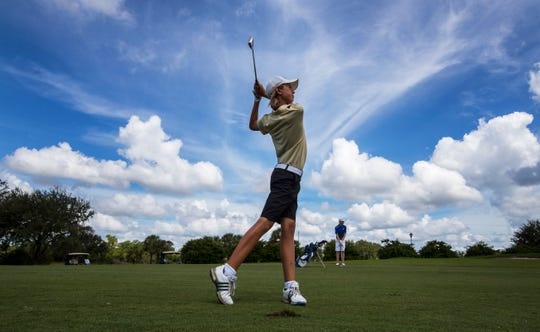 Logan Eakins, 14, of Fort Myers High School,  hits off the fairway at River Hall Golf and Country Club in Alva Monday afternoon. Eakins came in second place overall in the LCAC boys golf tournament.