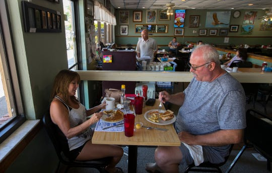 """Patrons enjoy breakfast at Annie's Restaurant in Cape Coral. Anne Herbert founded and owned Annie's Restaurant for 30 years until her death in January at  78. Now cousins Ron Demuro and Steven """"Bubba"""" DeMuro, from New Jersey, have bought the place, locally famous for its plate-sized pancakes."""