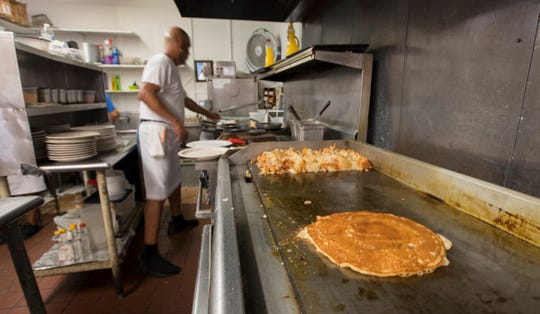 Jose Hernandez prepares one of Annie's Restaurant's famous plate-sized pancakes. Anne Herbert founded and owned the establishment for 30 years until her death in January at 78.