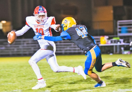 Oconto's Luke Krueger rushes Sturgeon Bay quarterback Jack Schmelzer and sacks him for a loss on the play in their game Friday, Sept. 28 in Oconto.