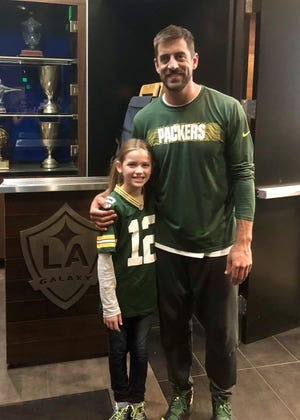 Nine-year-old Brooklyn Morse of California stars with Aaron Rodgers in a new Bose commercial.