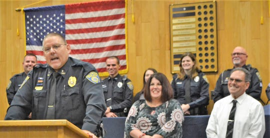 Oconto Police Chief Mike Rehberg speaks at his pinning ceremony on Friday, Sept. 28 at Oconto City Hall. Behind him at right are City Administrator Sara Perrizo and Mayor Lloyd Heier. Behind them, from left, is officer Mike Damit, officer Brandon Tousey, officer Nicole Crocker and Sgt. Glenn Sowle.