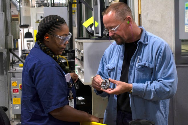 Kiya Mooney (left) a senior at Milwaukee Trade & Tech High School works with her mentor at Harley-Davidson. She is enrolled in the Manufacturing-Industrial Equipment program pathway through MPS's Youth Apprenticeship program.