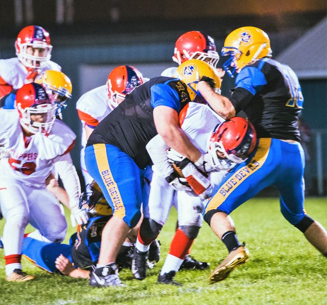 Oconto's Joe Reed stops Sturgeon Bay short of a first down in second quarter of action of their game on Friday, Sept. 28  Zach Sherman assists on the play.