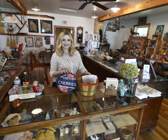 Bailey Koepsel of Egg Harbor is the new executive director of the Door County Historical Society. She is photographed inside the Greene Store at the society's Heritage Village at Big Creek, Sturgeon Bay.