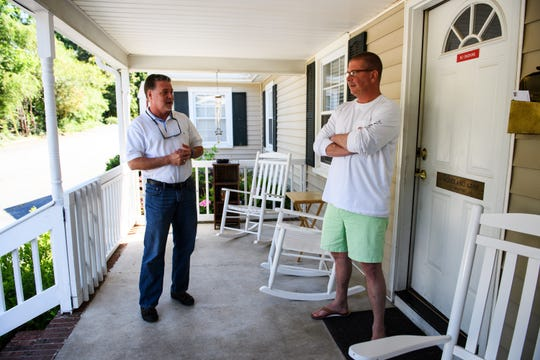 Mike Todd, left, and Heath Hood of Freedom House talk on the porch of the Greenville recovery residence on Wednesday, June 6, 2018.