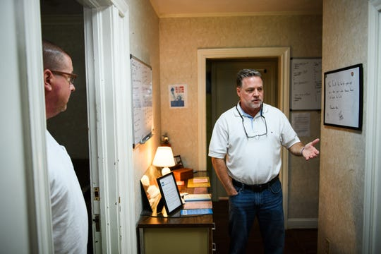 Mike Todd, right, and Heath Hood of Freedom House, talk about the services they offer for people recovering from addiction.