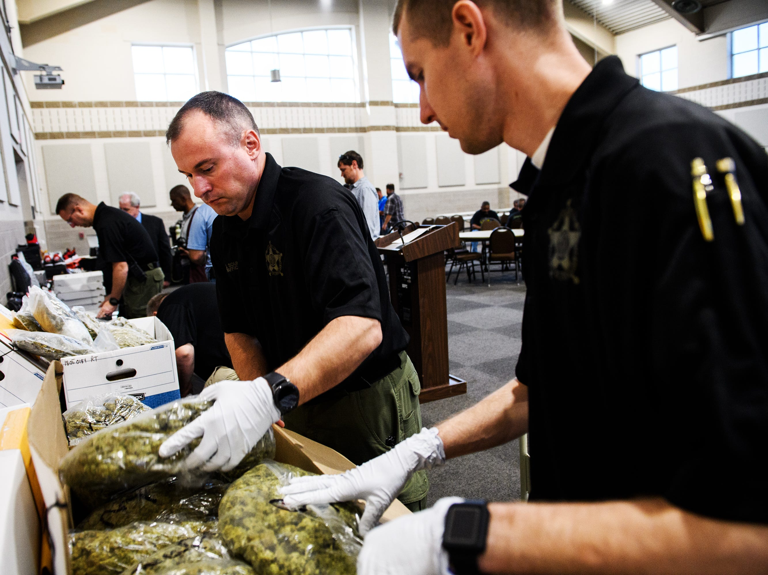 Spartanburg sheriff's deputies pack up bags of marijuana seized during Operation Rolling Thunder on Friday, May 4, 2018. Authorities seized a total 60 pounds of marijuana over four days.