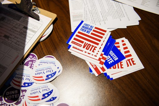 Voting stickers are on display at a Dins Vote station at Furman University on Tuesday, Sept. 25, 2018.