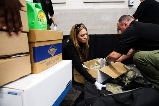 Spartanburg sheriff's deputies pack up bags of marijuana and other contraband after a press conference on the success of Operation Rolling Thunder. Without the incentive for officers' departments to profit from cash seizures, Rolling Thunder wouldn't exist, critics say.