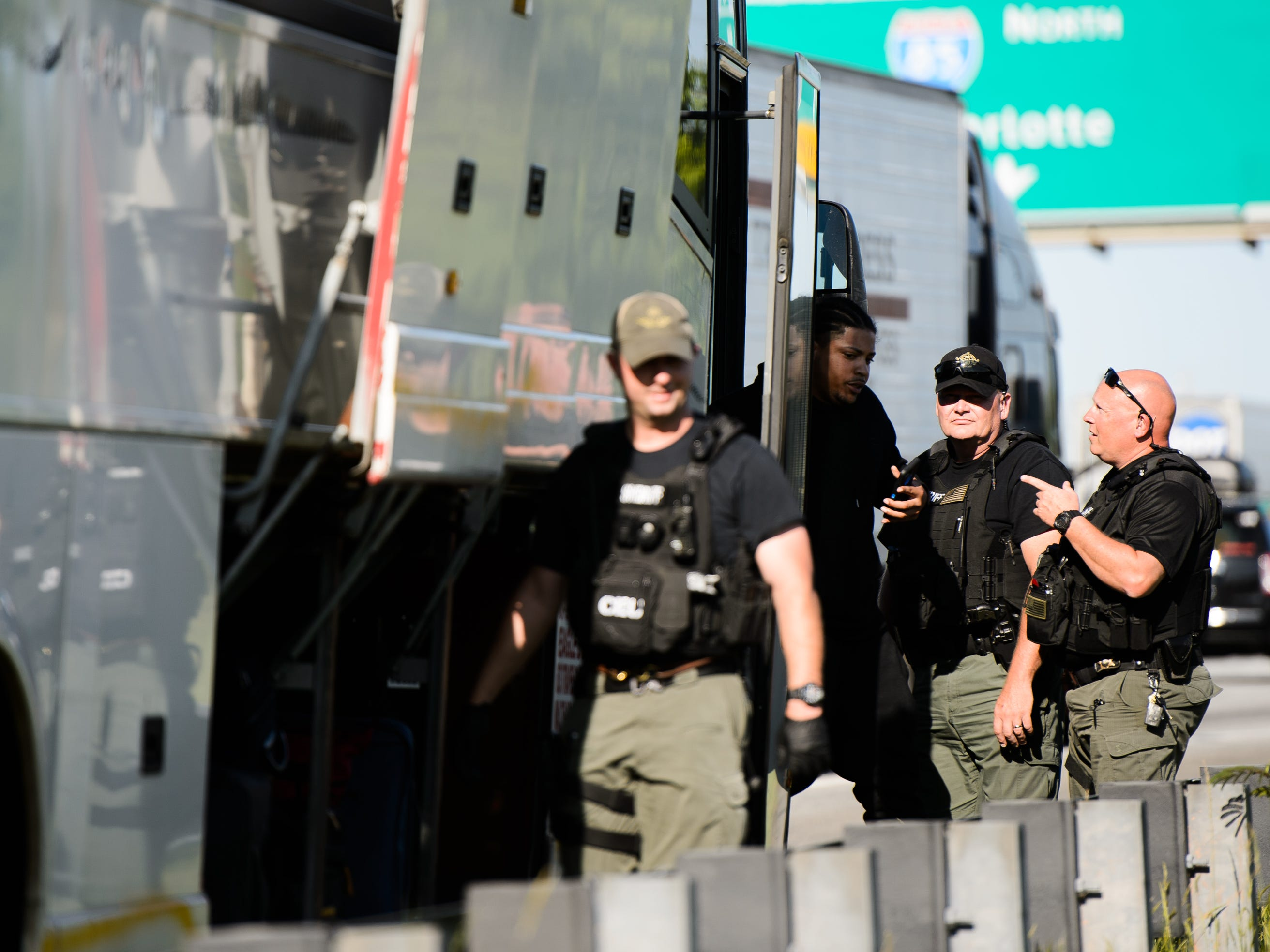 Florence County deputies search a passenger bus on the side of Interstate 85 in Spartanburg County on May 1, 2018. Hundreds of law enforcement agents descend on the county's highways each year during Operation Rolling Thunder.