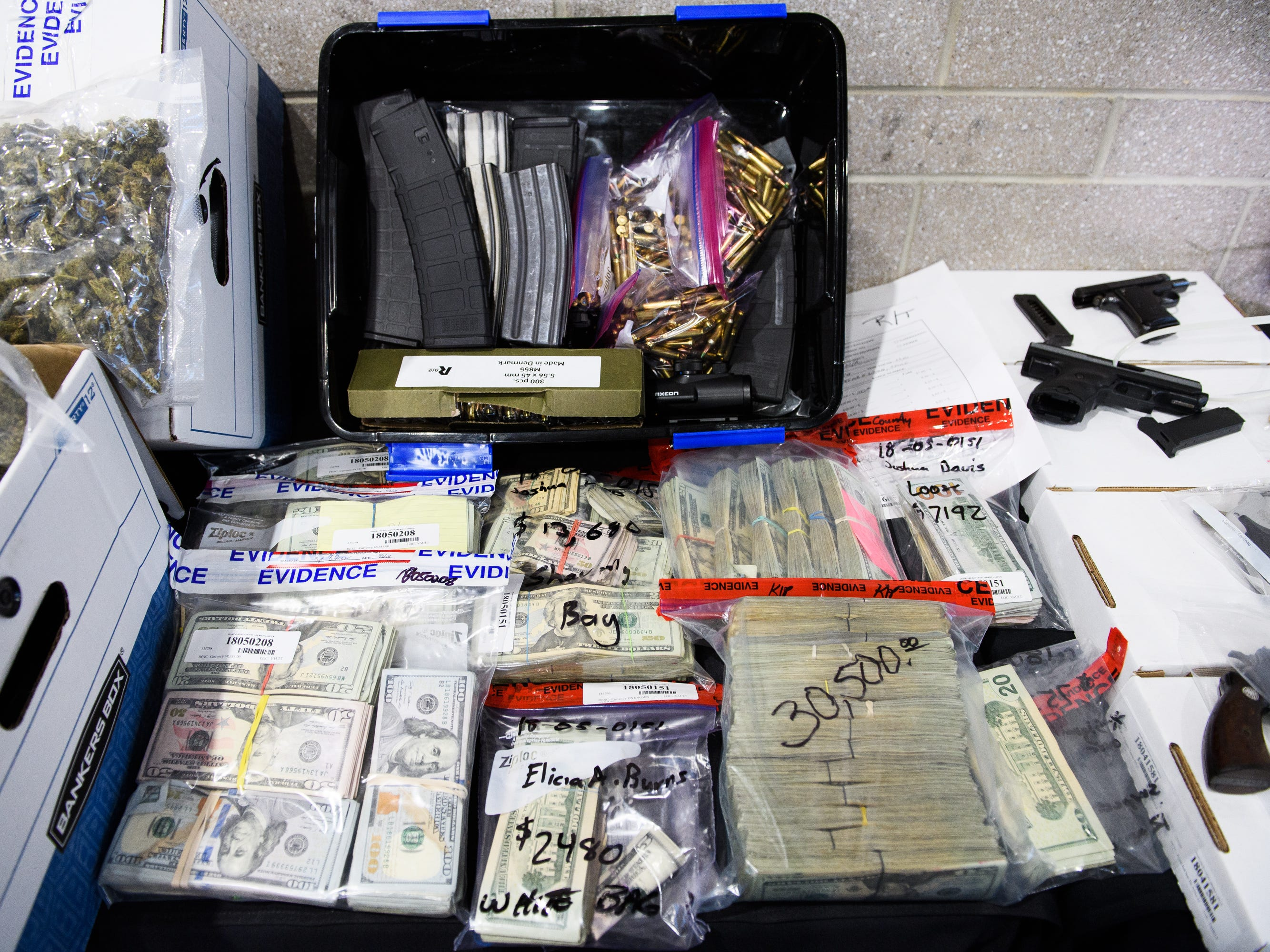 Large quantities of marijuana, money, firearms and other contraband sit on display during a Spartanburg County Sheriff's Office press conference on Operation Rolling Thunder's seizures on Friday, May 4, 2018.