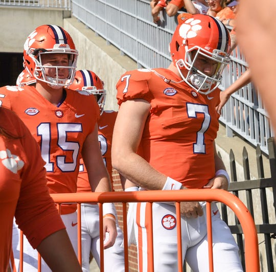 Clemson quarterbacks Patrick McClure (15), left, and Chase Brice (7) enter the field for warm ups before the Syracuse game before in Memorial Stadium on Saturday, September 29, 2018.