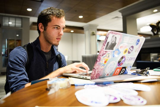 Ethan Kohrt registers to vote at Furman University on Tuesday, Sept. 25, 2018.