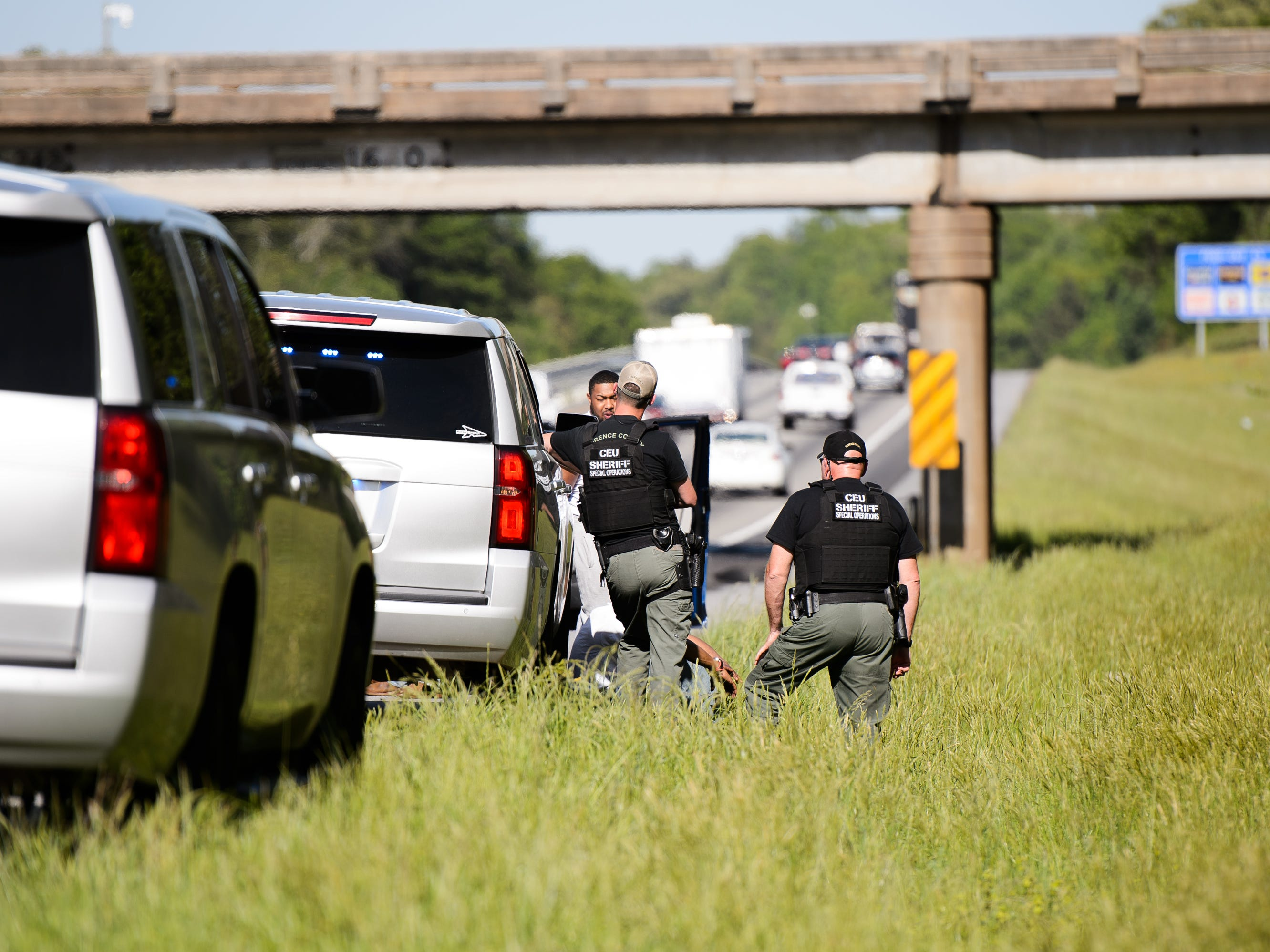 Law enforcement officers search a vehicle on Interstate 85. On average, officers search every fifth stopped car during Rolling Thunder 2018— hundreds of vehicles in all. They bring in a drug-sniffing dog128 times They make 40 arrests, 25 of them for felony offenses.