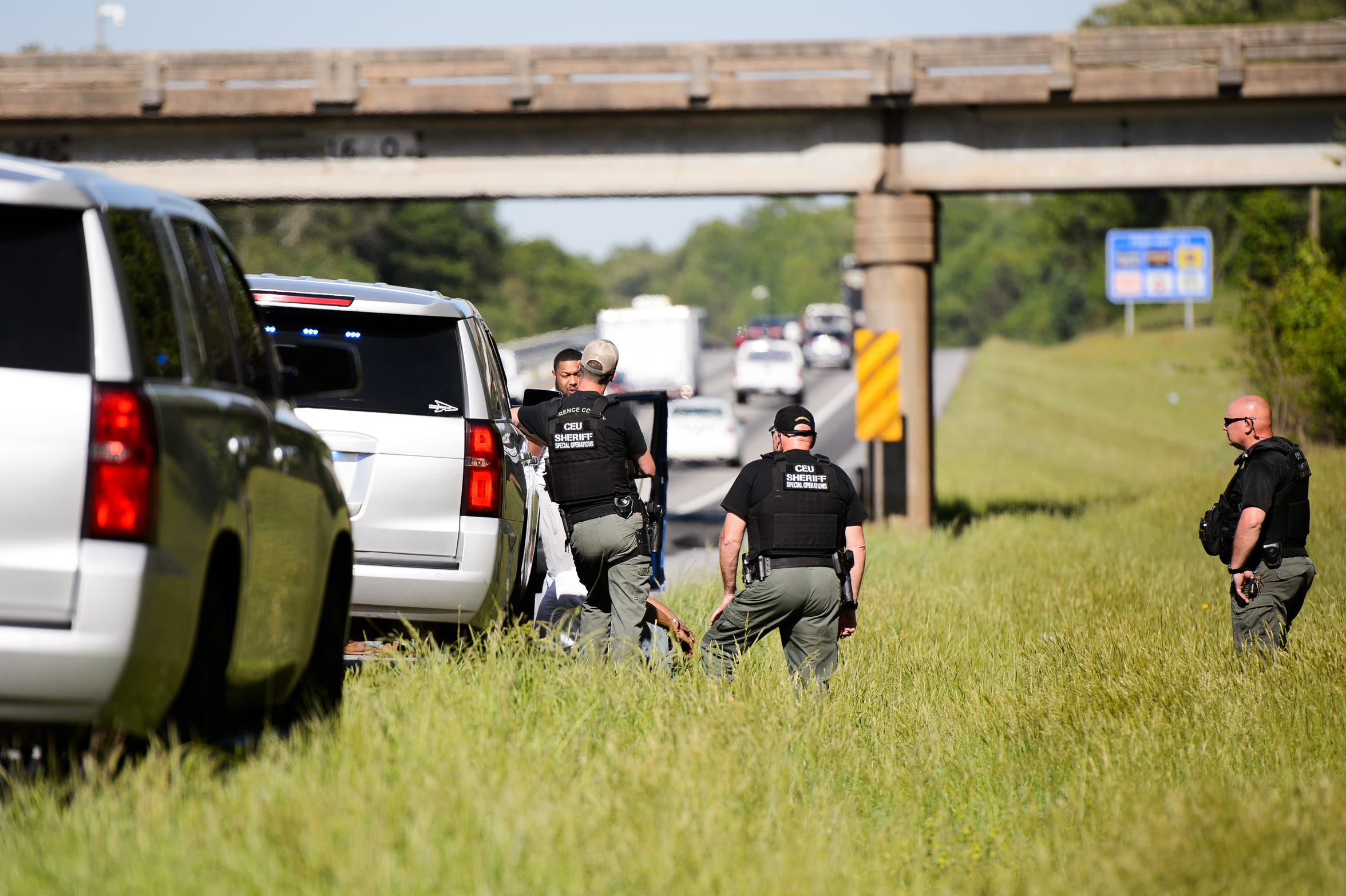 Law enforcement officers search a vehicle on Interstate 85. On average, officers search every fifth stopped car during Rolling Thunder 2018 — hundreds of vehicles in all. They bring in a drug-sniffing dog 128 times They make 40 arrests, 25 of them for felony offenses.