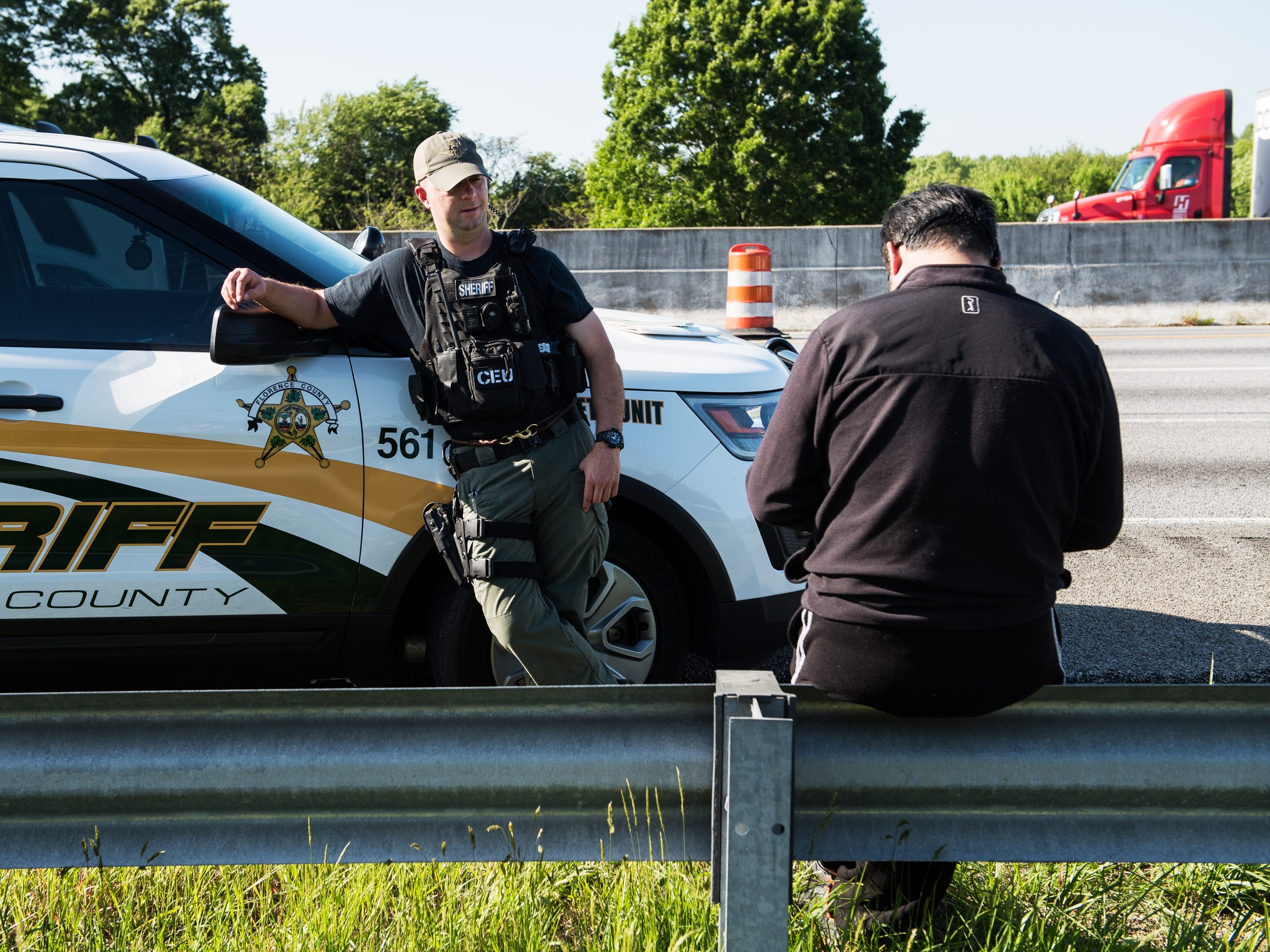 """A Florence County Sheriff's Office deputy stands next to a man who was pulled over as part of Operation Rolling Thunder on Interstate 85 in Spartanburg County.  The whole thing is """"kindalike fishing,"""" Spartanburg sheriff'sCpl. Danny Blackwell said."""