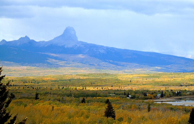 Chief Mountain and fall colors along the eastern edge of Glacier National Park in late September near Babb, Montana.
