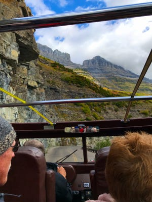 View from a jammer's red bus on Going-to-the-Sun Road in Glacier National Park