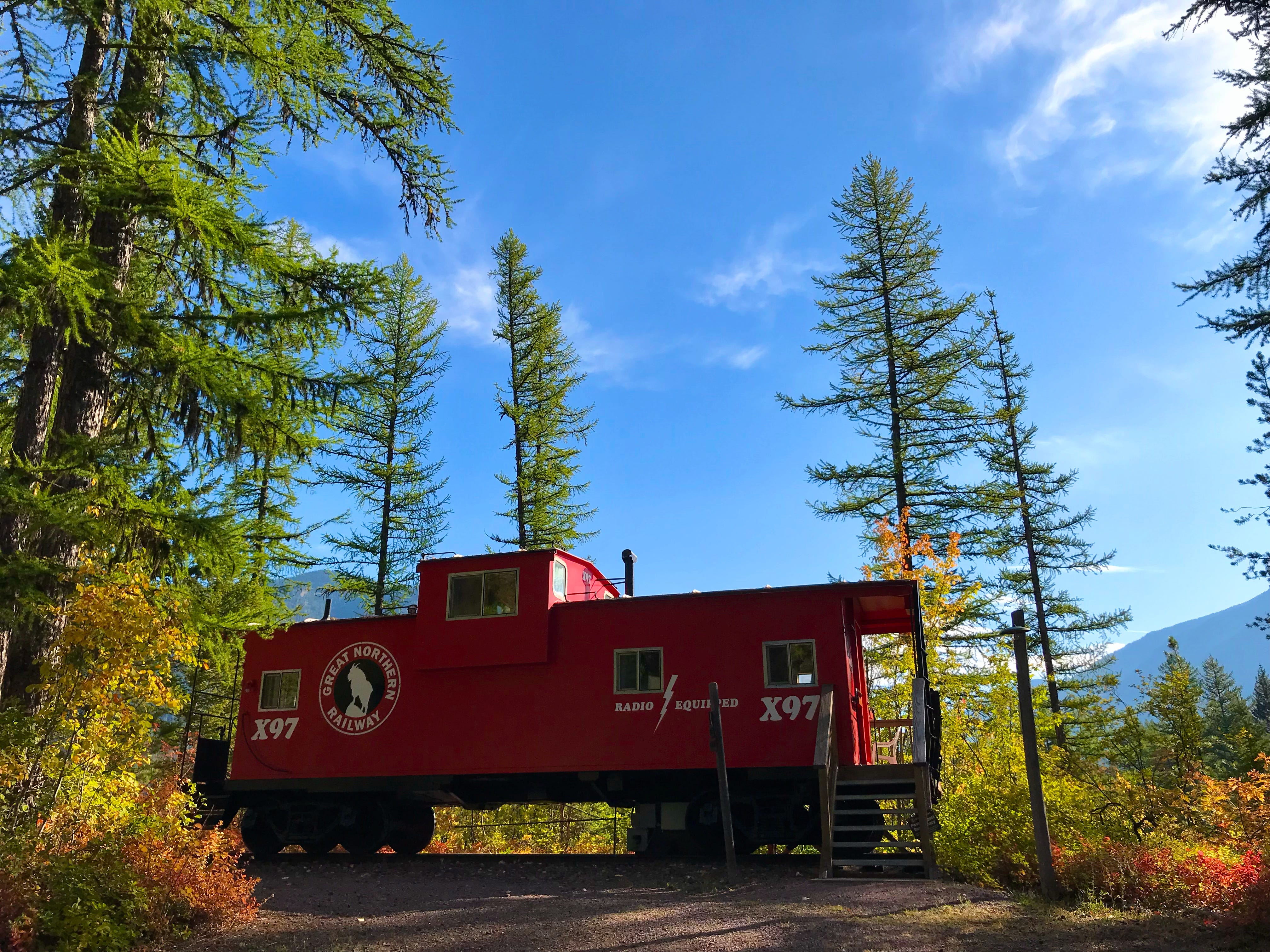 A caboose at the Izaak Walton Inn is set among fall colors