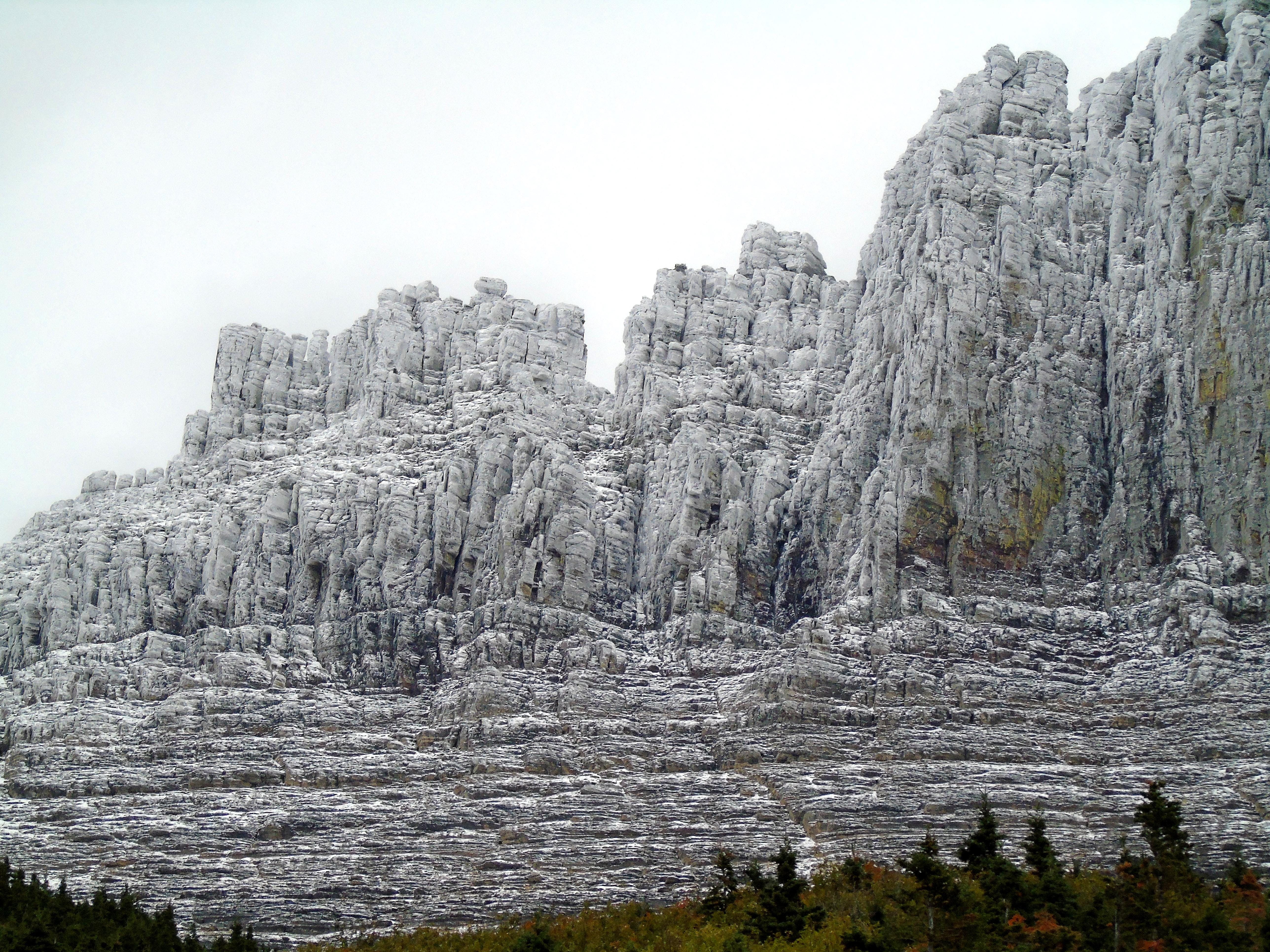 Snow dusts rugged mountains along Going-to-the-Sun Road in Glacier National Park in late September.
