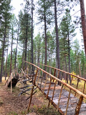 German artist Cornelia Konrads built this bridge, pieces at its center suspended mid fall -- or rise -- in Lincoln's Blackfoot Pathways: Sculpture in the Wild sculpture park.