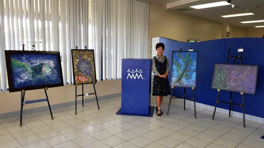 Local artist Yeon Sook Park displayed her art as part of Guam Council of the Arts and Humanities Agency mini-exhibit at Community First Federal Credit Union,  Dededo on Sept. 20. Park has been rotating her artwork every other month in CAHA's art exhibit.