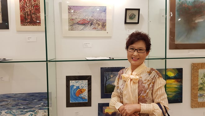 """Yeon Sook Park donated and displayed  her artwork during the Project Inspire Foundation's silent auction """"LIFE! CAMERA! ACTION! Gala on Sept. 27."""" The charity fundraiser promoted mental health awareness and suicide prevention held at Tumon Sands Plaza. Park also received a certificate of recognition from Sens. Therese M. Terlaje; acting speaker and Régina Biscoe Lee, chairperson, committee on rules, legislative secretary, and sponsor."""