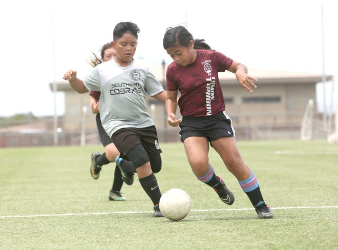 GPSI Southern Cobras and the Tumon Typhoons FC play in a Week 4 U11 Division match of the Triple J Auto Group Robbie Webber Youth Soccer League Saturday at the Guam Football Association National Training Center.