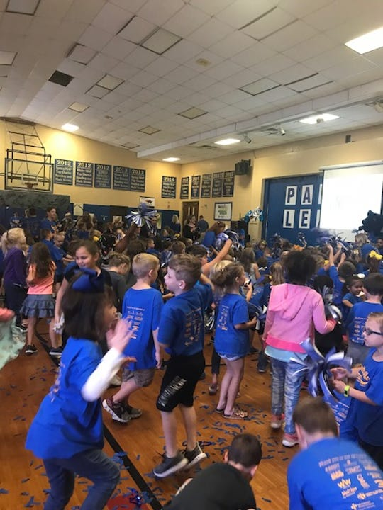 Students at Spottsville celebrate their Blue Ribbon win Monday.