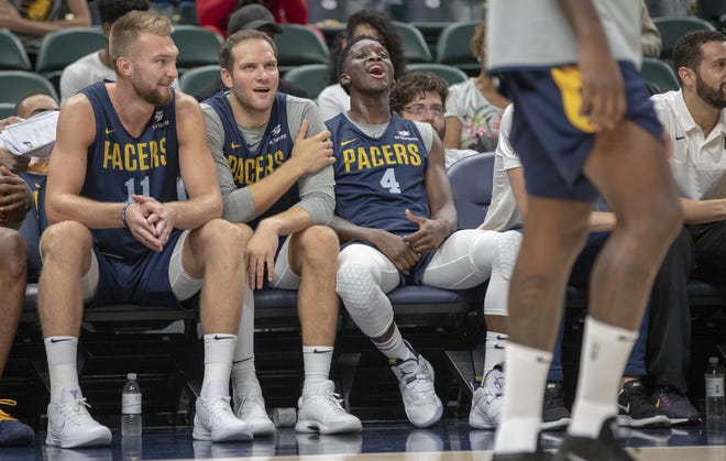 Players have a laugh from the bench during the day's Pacers FanJam to kick off the 2018-2019 season, Sunday, Sept. 30, 2018. A scrimmage was played, along with a photo session with players, a three-point contest, and performances by the Pacers Power Pack gymnasts, and Pacemates dance team.