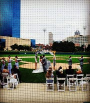 "Getting married at Victory Field ""let us showcase our favorite city,"" said bride Sarah Johnson."