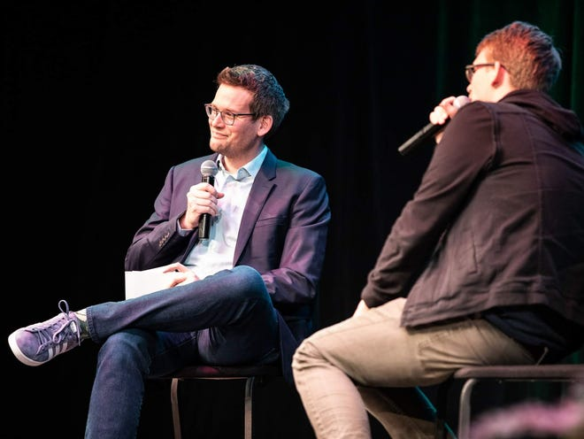 John Green, left, listens to his brother, Hank Green, during an  event to promote Hank's debut novel Sept. 30 at Clowes Hall.