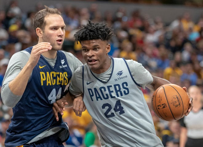 Alize Johnson works a possession against Bojan Bogdanovic during the day's Pacers FanJam to kick off the 2018-2019 season, Sunday, Sept. 30, 2018. A scrimmage was played, along with a photo session with players, a three-point contest, and performances by the Pacers Power Pack gymnasts, and Pacemates dance team.