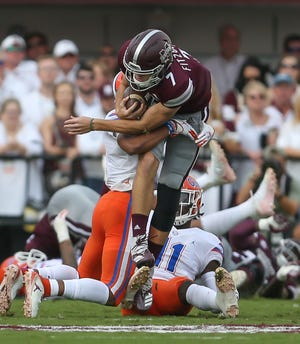 Mississippi State's Nick Fitzgerald (7) jumps over defenders in the first quarter of the Bulldogs' 23-9 win over No. 9 Auburn Saturday night in Starkville.  Photo by Keith Warren