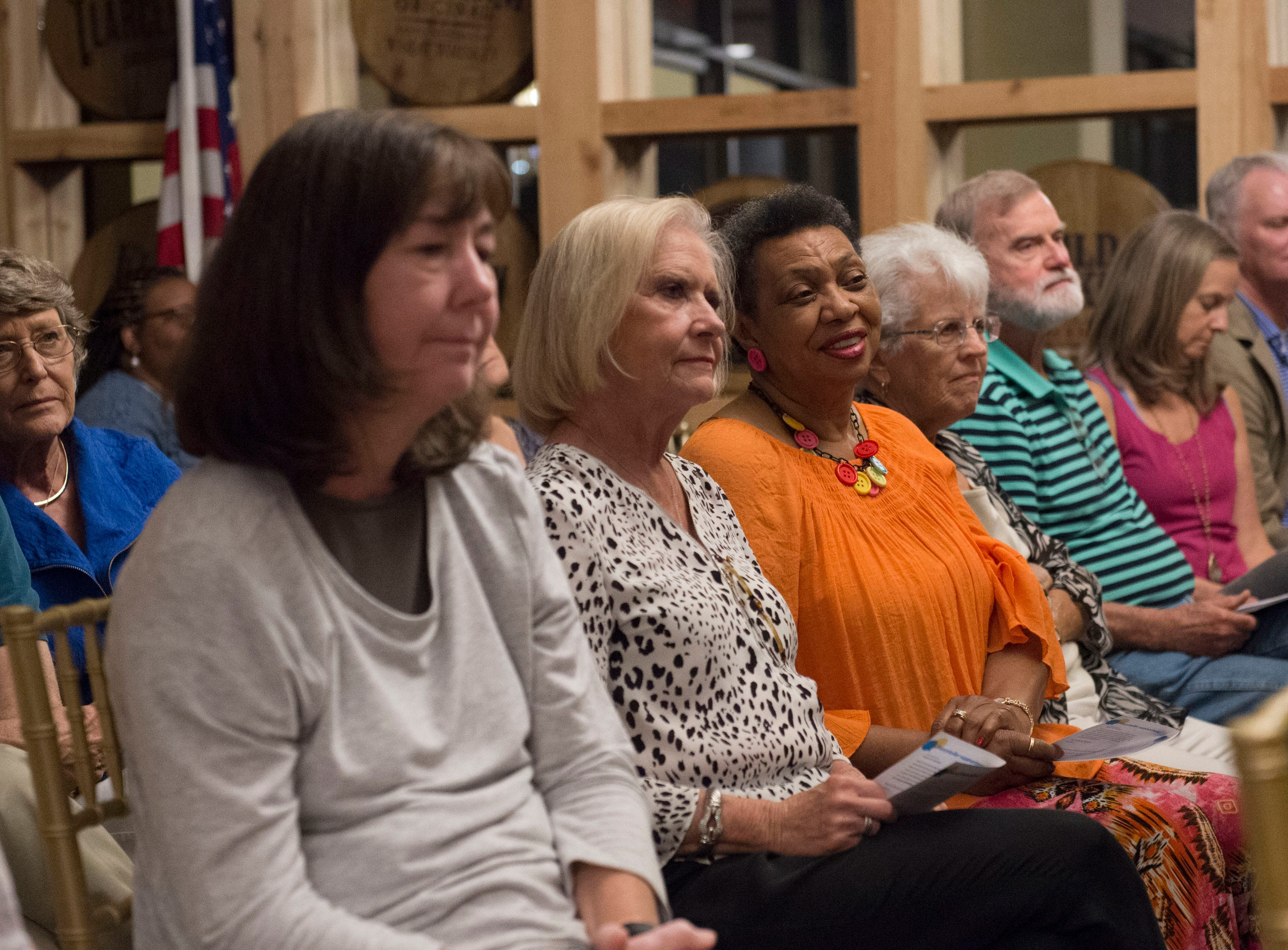 Guests listen intently at Mississippi Storytellers: Growing Up, a night of storytelling by Jacksonians, held at Rickhouse. Tuesday, Sept. 18, 2018.
