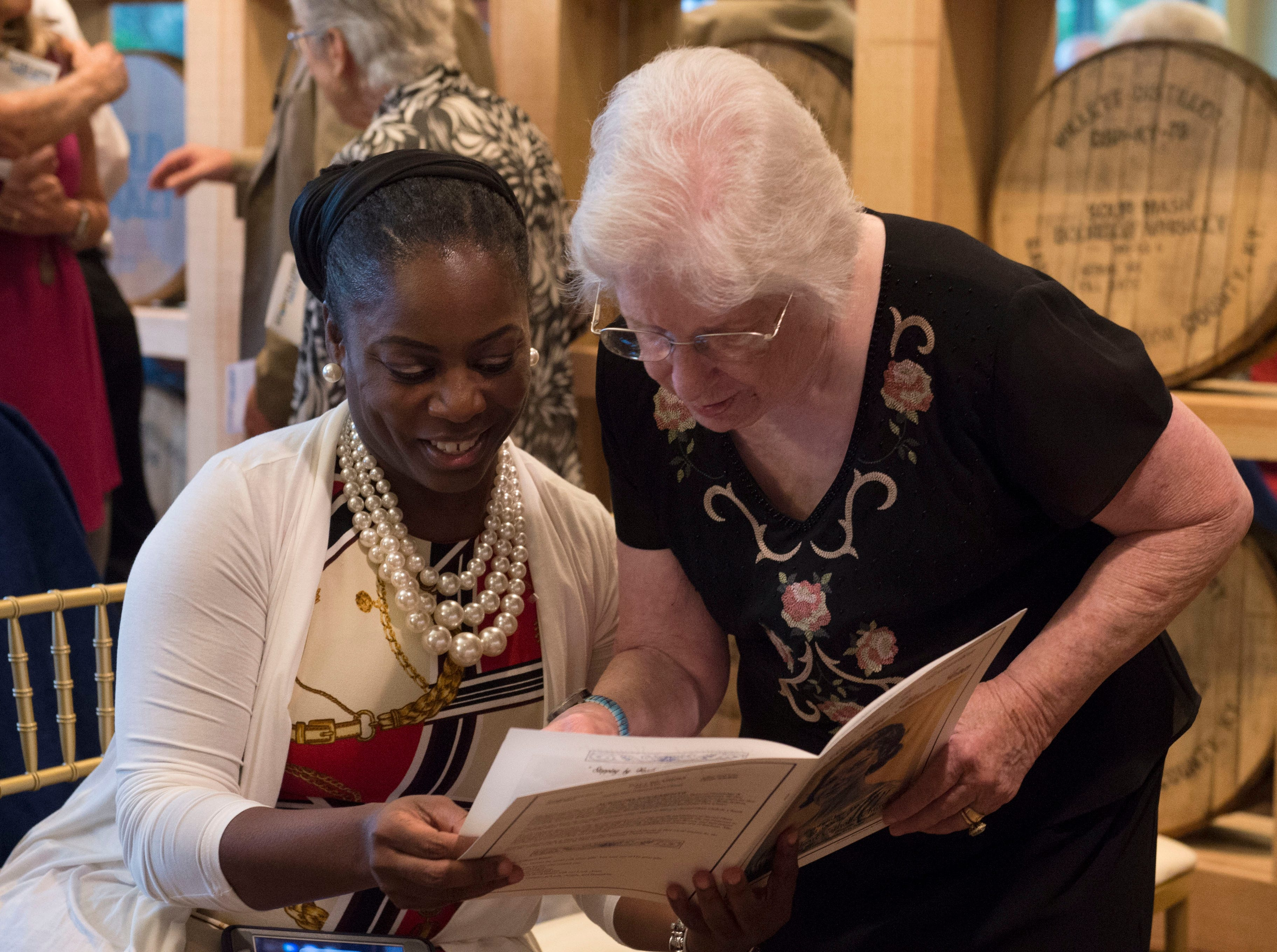 Mississippi Storytellers Tonja Murphy (left) and Nash Noble (right) visit before they share their stroes about 'growing up' at Rickhouse in Jackson. Tuesday, Sept. 18, 2018.