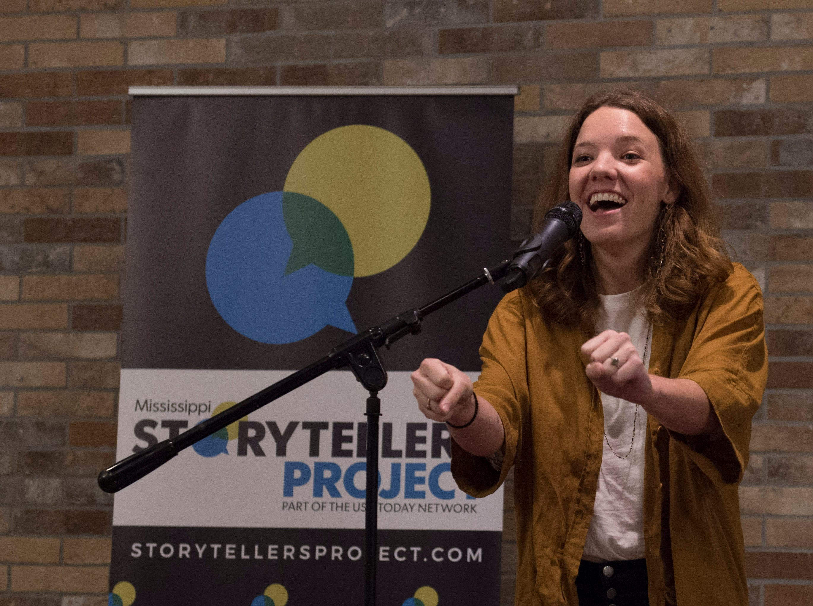 Clare Parrish talks about how a car named Debra moved her — and not just down the road during Mississippi Storytellers: Growing Up held at Rickhouse in Jackson. Tuesday, Sept. 18, 2018.