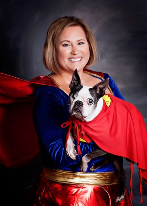 Milisa Rhodes, an honoree at the upcoming Bone Bash on Oct. 13, will dress as superwoman with her dog Munchkin as superman during the event. Both she and Munchkin have been diagnosed with arthritis.