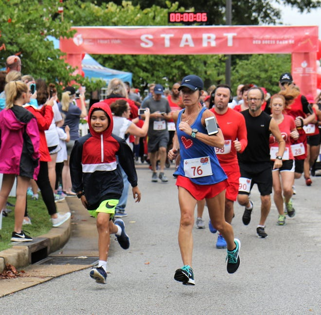 Runners head out from the starting line as they begin the Red Dress Dash 5K during the annual Heart Walk Sept. 22, 2018, at Union University.