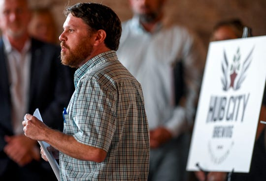 Matt Altobell, the executive director of Jackson Downtown Development Corporation, speaks to a crowd gathered during the announcement of Hub City Brewing, a tap room to open in a former Ford Model T dealership at 250 W Main Street in Jackson, Tenn., on Monday, Oct. 1, 2018.