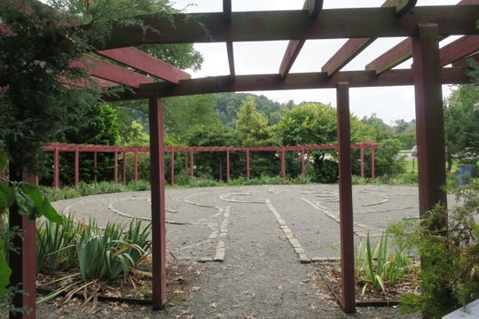 The University of Tennesee Gardens' labyrinth is surrounded by a red arbor.