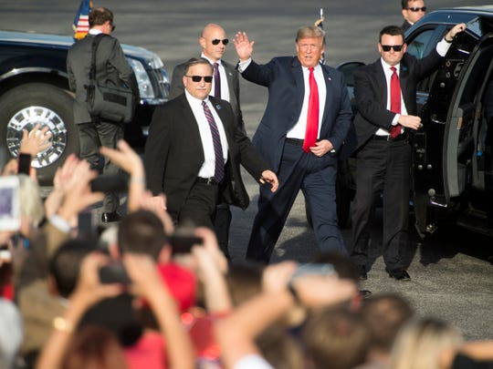 President Donald Trump waves to the crowd gathered at Tri-City Aviation on Monday, October 1, 2018.