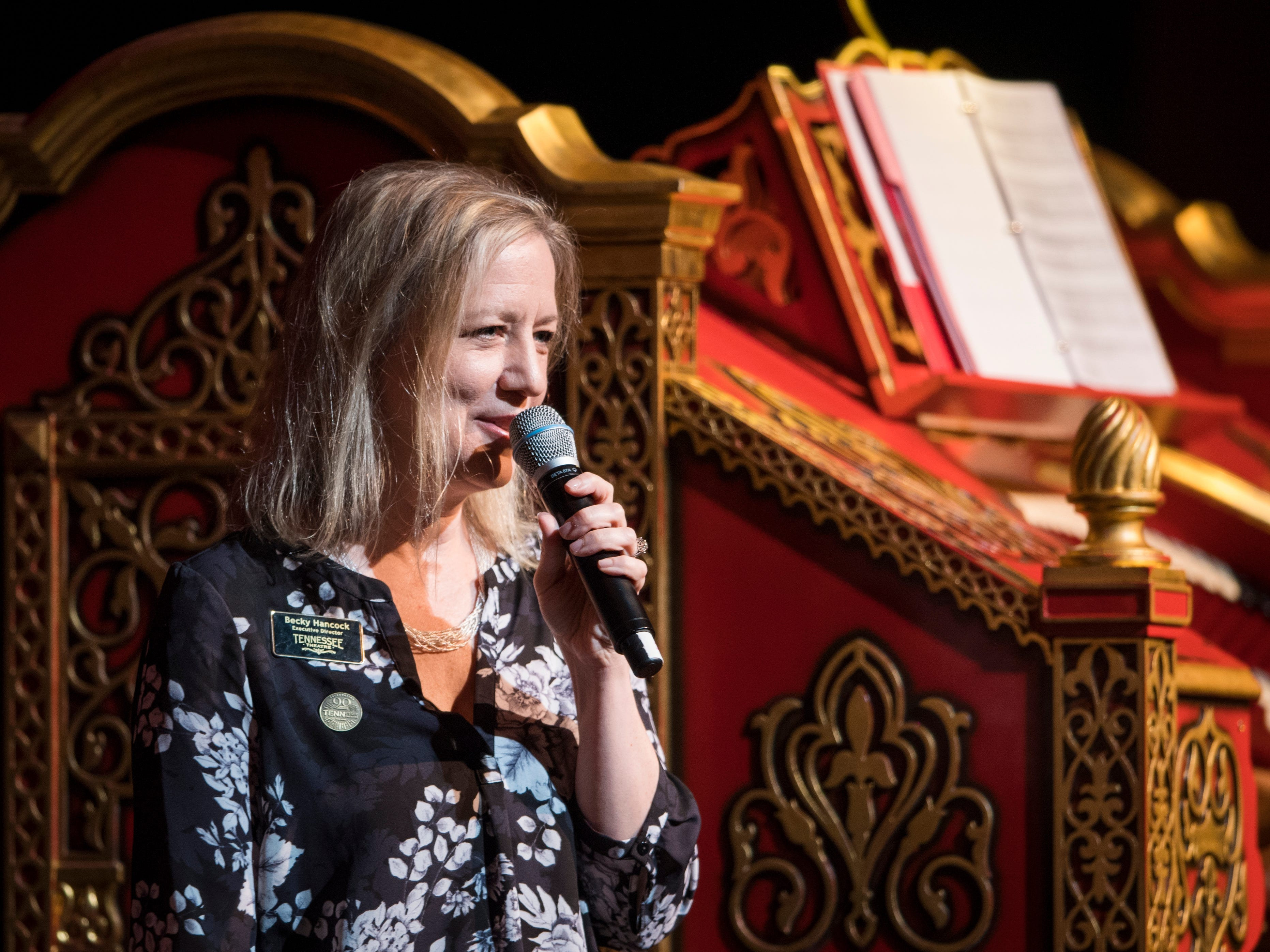 Tennessee Theatre executive director Becky Hancock speaks during Mighty Musical Monday celebrating the retirement of Dr. Bill Snyder at the downtown Knoxville theatre on Monday, October 1, 2018. This particular Mighty Musical Monday also landed on the Tennessee Theatre's 90th anniversary.