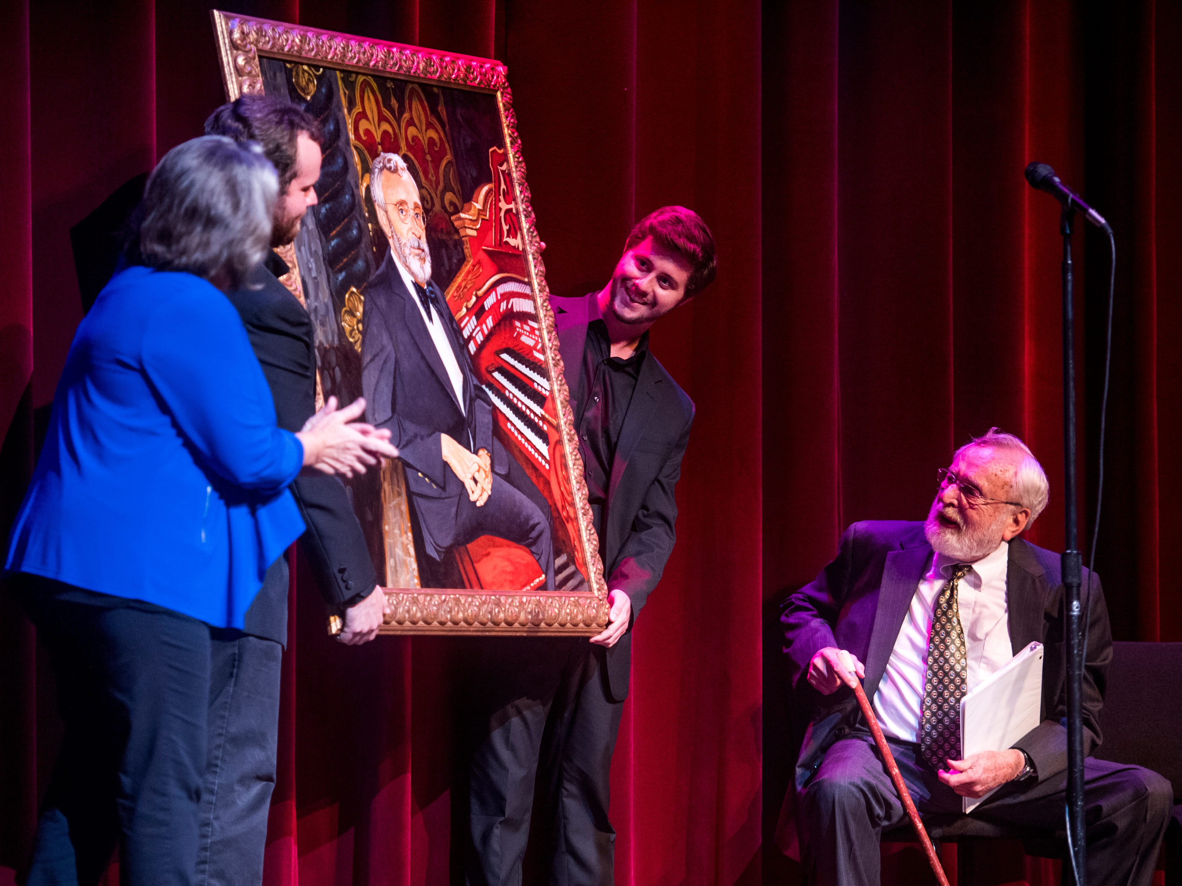 A painted portrait of Dr. Bill Snyder that will be hung in the Tennessee Theatre is unveiled during a special Mighty Musical Monday celebrating Dr. Bill Snyder's retirement at the downtown Knoxville theatre on Monday, October 1, 2018. Snyder has been the organist at the theater since 1979. This particular Mighty Musical Monday also landed on the Tennessee Theatre's 90th anniversary.