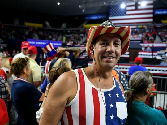 Supporter Ricardo Harbin from Kingsport inside Freedom Hall waiting for President Donald J. Trump's Make America Great Again Rally for Marsha Blackburn Monday, October 1, 2018 in Johnson City.