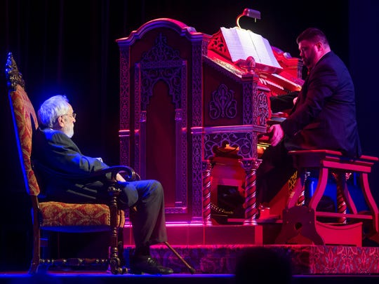 Freddie Brabson, who has assumed the role of house organist at the Tennessee Theatre, plays the Mighty Wurlitzer organ as Dr. Bill Snyder, left, listens during a special Mighty Musical Monday celebrating Snyder's retirement Oct. 1.