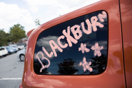 A car window was painted in support of Republican U.S. Senate candidate Marsha Blackburn before a rally featuring President Donald Trump at Freedom Hall Civic Center in Johnson City, Monday, Oct. 1, 2018.